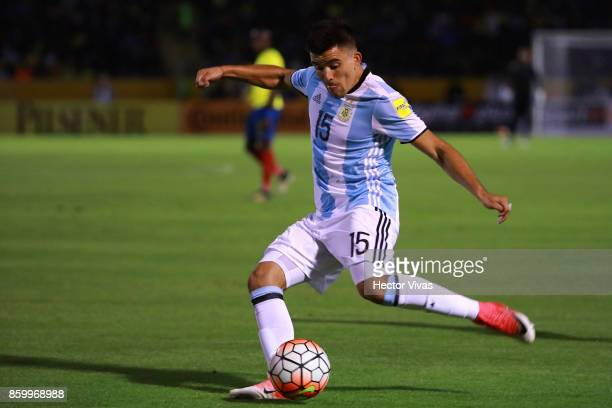 Marcos Acuña of Argentina takes a shot during a match between Ecuador and Argentina as part of FIFA 2018 World Cup Qualifiers at Olimpico Atahualpa...