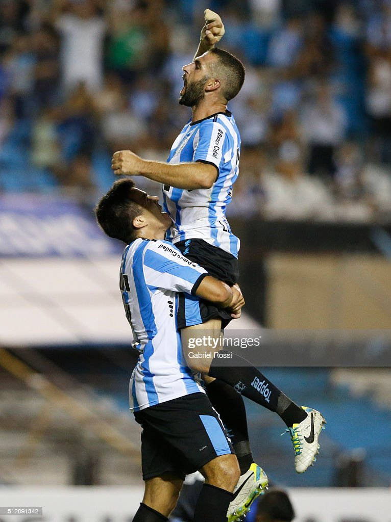 Marcos Acuña of Racing Club and teammates celebrate their team's fourth goal during a group stage match between Racing Club and Bolivar as part of Copa Bridgestone Libertadores 2016 at Presidente Peron Stadium on February 24, 2016 in Avellaneda, Argentina.