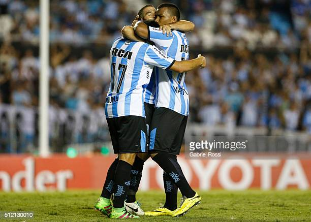 Marcos Acuña of Racing Club celebrates with his teammates after scoring the fourth goal of his team during a group stage match between Racing Club...