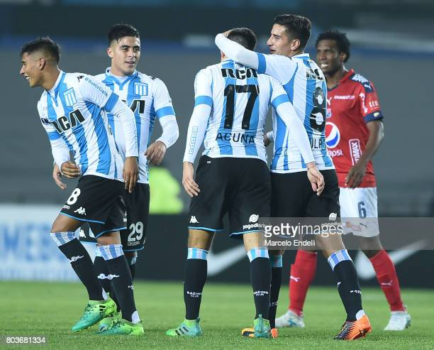 Marcos Acuña of Racing Club celebrates with teammates after scoring the third goal of his team during the first leg match between Racing Club and...