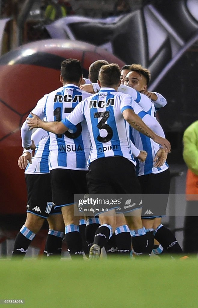 Marcos Acuña of Racing Club celebrates with teammates Lautaro Martinez, Luciano Aued and Leandro Grimi after scoring the third goal of his team during a match between River Plate and Racing Club as part of Torneo Primera Division 2016/17 at Monumental Stadium on June 18, 2017 in Buenos Aires, Argentina.