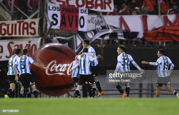 Marcos Acuña of Racing Club celebrates with teammates Lautaro Martinez Luciano Aued and Leandro Grimi after scoring the third goal of his team during...