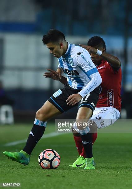 Marcos Acuña of Racing Club fights for ball with Carlos Valencia of Independiente Medellin during the first leg match between Racing Club and...