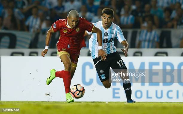 Marcos Acuña of Racing Club fights for the ball with Daniel Muñoz of Rionegro Aguilas during a first leg match between Racing and Rionegro Aguilas as...