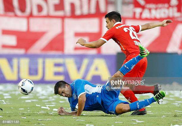 Marcos Acuña of Racing Club fights for the ball with Gustavo Toledo of Independiente during the 4th round match between Independiente and Racing Club...