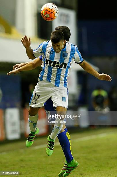 Marcos Acuña of Racing Club fights for the ball with Leonardo Rafael Jara of Boca Juniors during a group stage match between Boca Juniors and Racing...