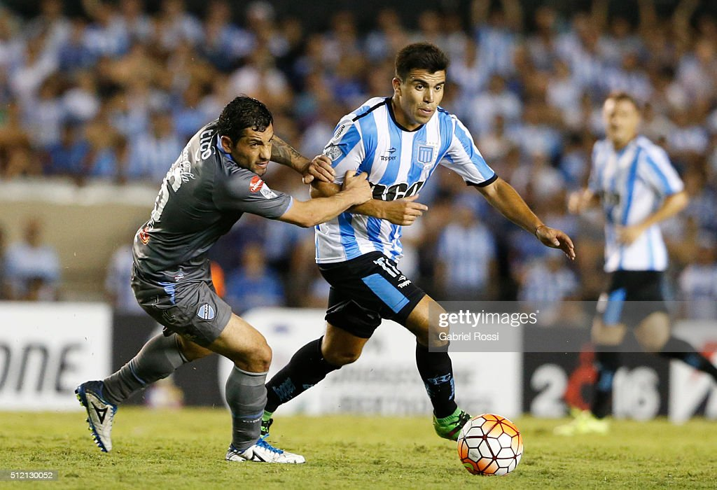 Marcos Acuña of Racing Club fights for the ball with Walter Flores of Bolivar during a group stage match between Racing Club and Bolivar as part of Copa Bridgestone Libertadores 2016 at Presidente Peron Stadium on February 24, 2016 in Avellaneda, Argentina.