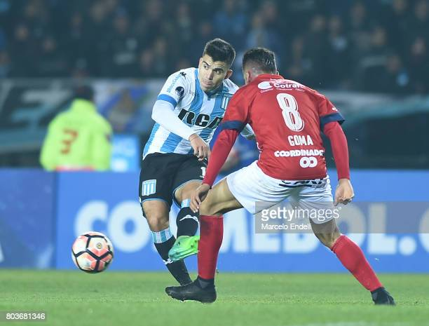 Marcos Acuña of Racing Club kicks the ball during the first leg match between Racing Club and Independiente Medellin as part of second round of Copa...