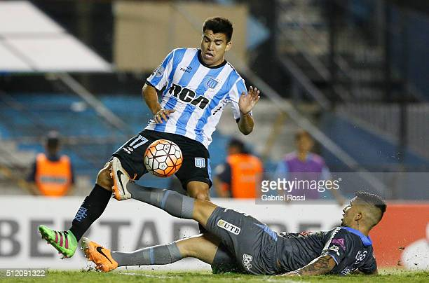 Marcos Acuña of Racing Club kicks the ball to score the fourth goal of his team during a group stage match between Racing Club and Bolivar as part of...