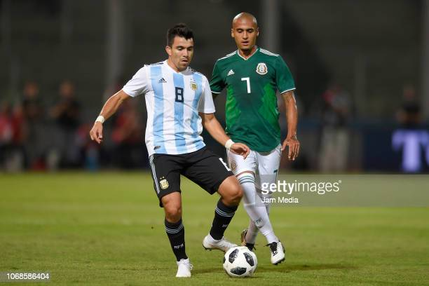 Marcos Acuna of Argentina battles for possession with Luis Rodriguez of Mexico during a friendly match between Argentina and Mexico at Mario Kempes...