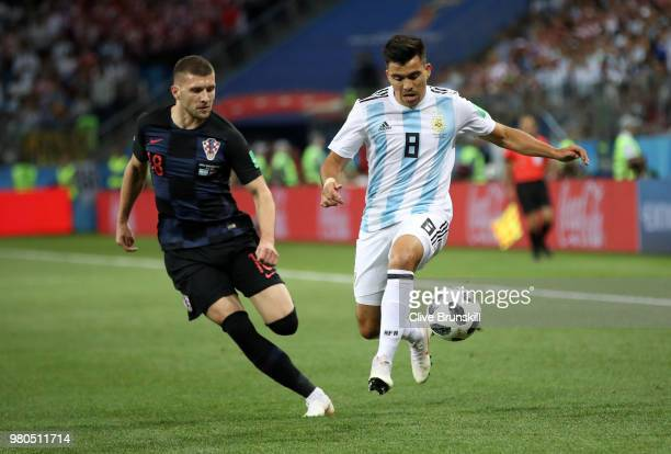 Marcos Acuna of Argentina is challenged by Ante Rebic of Croatia during the 2018 FIFA World Cup Russia group D match between Argentina and Croatia at...