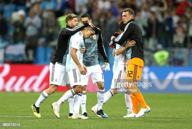 Marcos Acuna of Argentina is consoled by team mate Cristian Ansaldi during the 2018 FIFA World Cup Russia group D match between Argentina and Croatia...