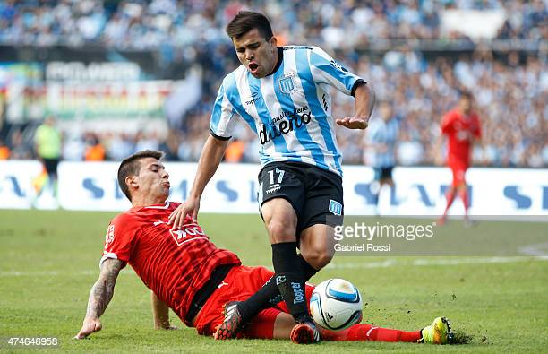 Marcos Acuna of Racing Club is fouled by Victor Cuesta of Independiente during a match between Racing Club and Independiente as part of 13th round of...