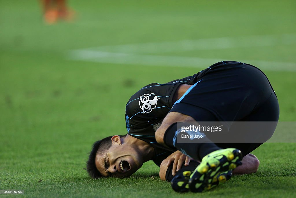 Marcos Acuna of Racing Club reacts after being tackled during a first leg match between Independiente and Racing Club as part of Pre Copa Libertadores Playoff at Libertadores de America Stadium on November 29, 2015 in Avellaneda, Argentina.