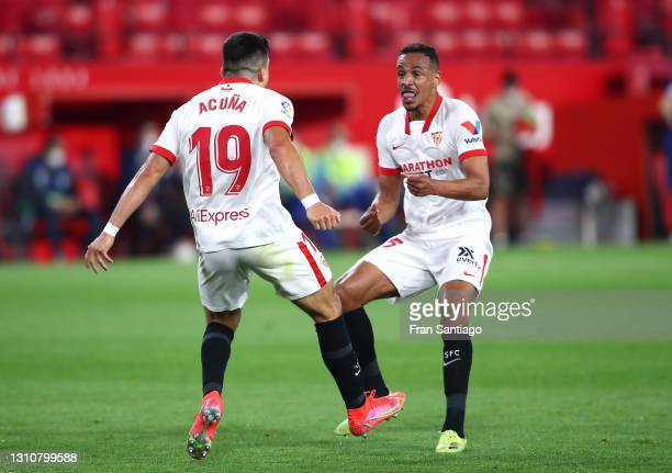 Marcos Acuna of Sevilla FC celebrates with teammate Fernando after scoring their team's first goal during the La Liga Santander match between Sevilla...