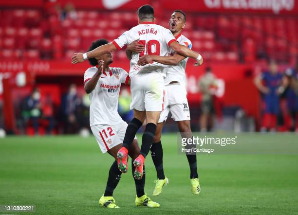 Marcos Acuna of Sevilla FC celebrates with teammates Jules Kounde and Fernando after scoring their team's first goal during the La Liga Santander...
