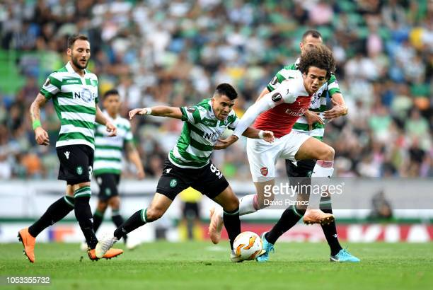 Marcos Acuna of Sporting CP chases Matteo Guendouzi of Arsenal during the UEFA Europa League Group E match between Sporting CP and Arsenal at Estadio...