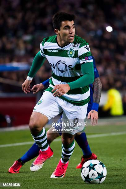 Marcos Acuna of Sporting CP conducts the ball under pressure from Aleix Vidal of FC Barcelona during the UEFA Champions League group D match between...