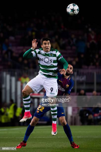 Marcos Acuna of Sporting CP heads the ball under pressure from Aleix Vidal of FC Barcelona during the UEFA Champions League group D match between FC...