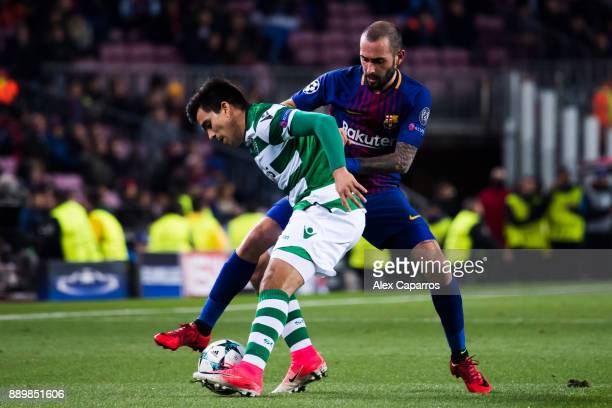 Marcos Acuna of Sporting CP protects the ball from Aleix Vidal of FC Barcelona during the UEFA Champions League group D match between FC Barcelona...