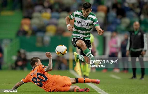 Marcos Acuna of Sporting CP with Junior Caicara of Istanbul Basaksehir in action during the UEFA Europa League Round of 32 - First Leg match between...