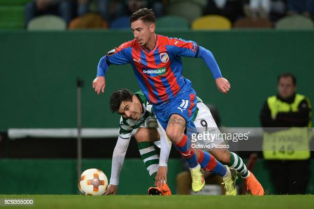 Marcos Acuna of Sporting Lisbon competes for the ball with Milan Petrzela of Viktoria Plzen during the UEFA Europa League Round of 16 first leg match...