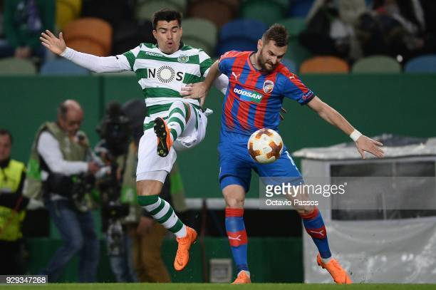Marcos Acuna of Sporting Lisbon competes for the ball with Radim Reznik of Viktoria Plzen during the UEFA Europa League Round of 16 first leg match...