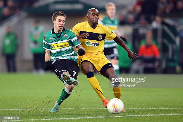 Marcos Airosa of Limassol challenges Patrick Herrmann of Moenchengladbach during the UEFA Europa League group C match between Borussia...