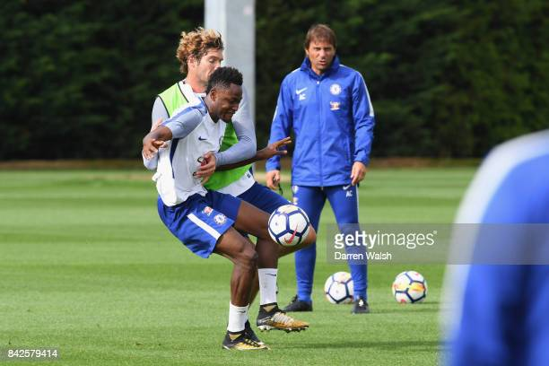 Marcos Alonso and Baba Rahman of Chelsea during a training session at Chelsea Training Ground on September 4 2017 in Cobham England