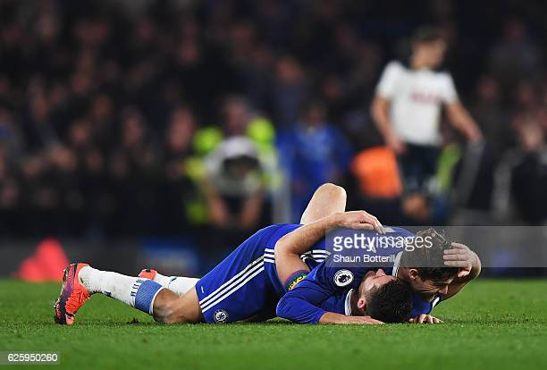 Marcos Alonso and Gary Cahill of Chelsea celebrate their team's 21 win in the Premier League match between Chelsea and Tottenham Hotspur at Stamford...
