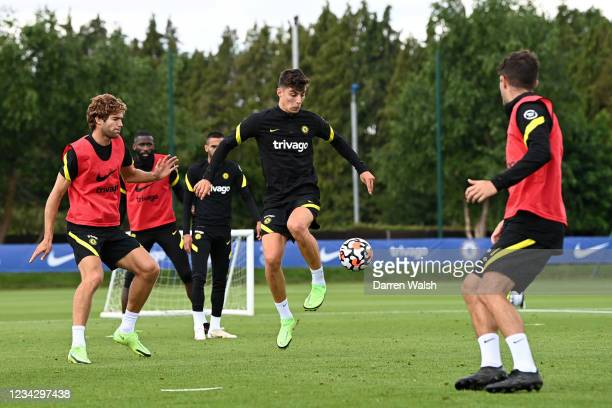 Marcos Alonso and Kai Havertz of Chelsea during a training session at Chelsea Training Ground on July 29, 2021 in Cobham, England.