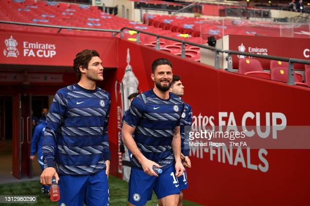 Marcos Alonso and Olivier Giroud of Chelsea walk out for the warm up prior to the Semi Final of the Emirates FA Cup match between Manchester City and...