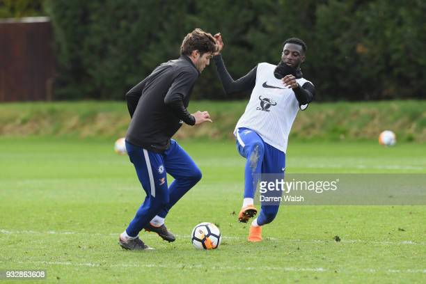 Marcos Alonso and Tiemoue Bakayoko of Chelsea during a training session at Chelsea Training Ground on March 16 2018 in Cobham United Kingdom