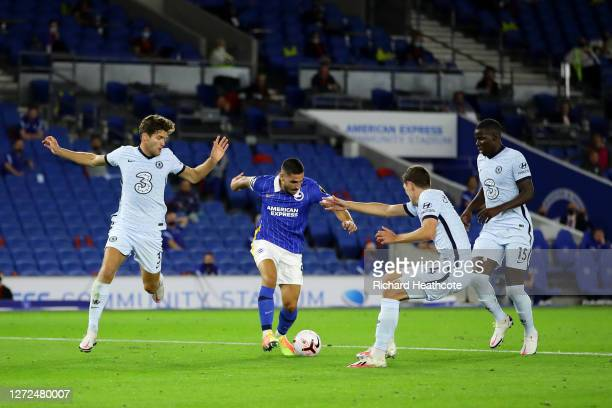 Marcos Alonso Andreas Christensen and Kurt Zouma of Chelsea surround Neal Maupay of Brighton and Hove Albion during the Premier League match between...