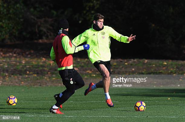 Marcos Alonso is challenged by Dominic Solanke during a Chelsea training session at Chelsea Training Ground on November 25 2016 in Cobham England