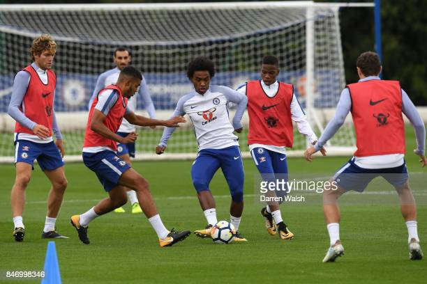 Marcos Alonso Jake ClarkeSalter Willian and Charly Musonda of Chelsea during a training session at Chelsea Training Ground on September 14 2017 in...