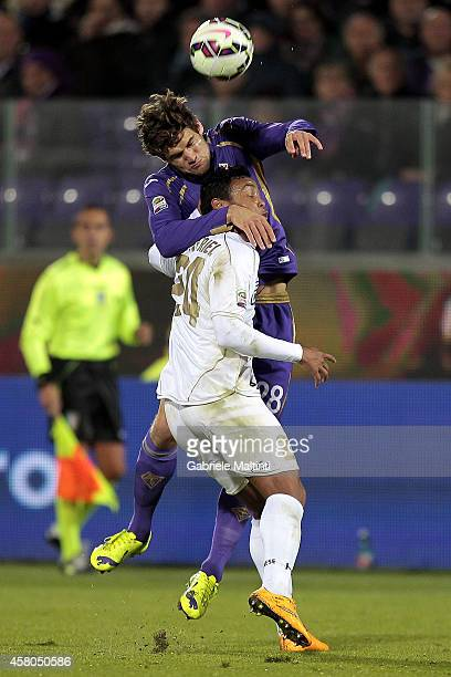 Marcos Alonso of ACF Fiorentina battles for the ball with Luis Muriel of Udinese Calcio during the Serie A match between ACF Fiorentina and Udinese...
