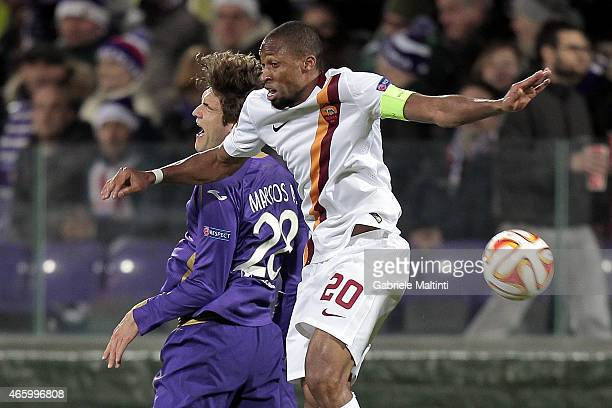 Marcos Alonso of ACF Fiorentina battles for the ball with Seydou Keita of AS Roma during the UEFA Europa League Round of 16 match between ACF...