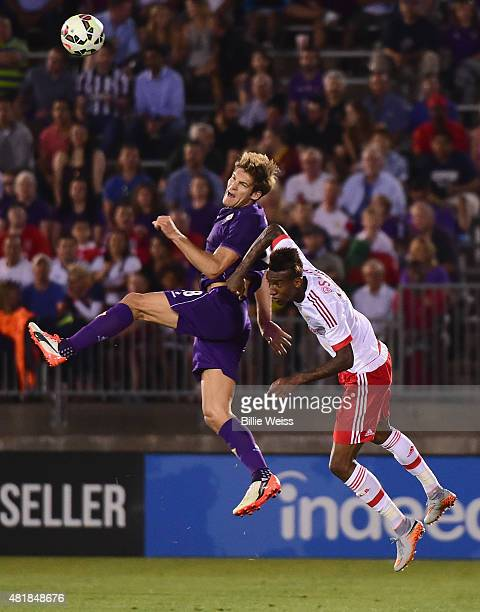 Marcos Alonso of ACF Fiorentina jumps for a ball as Anderson Talisca defends during the first half of an International Champions Cup 2015 match at...