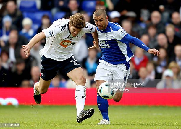 Marcos Alonso of Bolton in action with Kevin Phillips of Birmingham during the Barclays Premier League match between Birmingham City and Bolton...