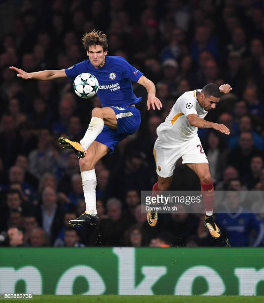 Marcos Alonso of Chelsea and Bruno Peres of AS Roma battle for possession in the air during the UEFA Champions League group C match between Chelsea...