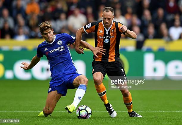 Marcos Alonso of Chelsea and David Meyler of Hull City battle for possession during the Premier League match between Hull City and Chelsea at KCOM...