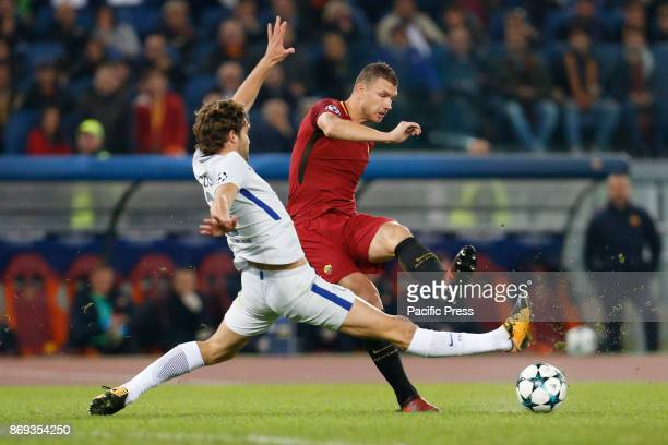 Marcos Alonso of Chelsea and Edin Dzeko of Roma fights for the ball during UEFA Champions League Group C soccer match between AS Roma and Chelsea FC...