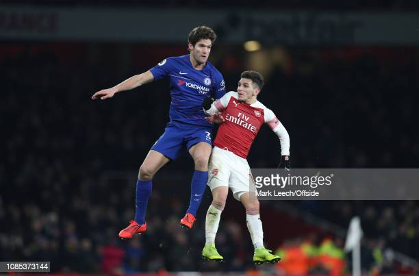 Marcos Alonso of Chelsea and Lucas Torreira of Arsenal jump for the ball during the Premier League match between Arsenal FC and Chelsea FC at...
