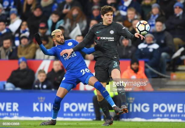 Marcos Alonso of Chelsea and Riyad Mahrez of Leicester City battle for the ball during The Emirates FA Cup Quarter Final match between Leicester City...