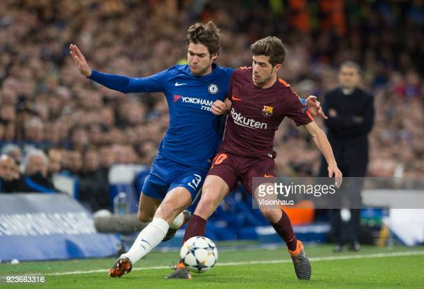 Marcos Alonso of Chelsea and Sergi Roberto of Barcelona during the UEFA Champions League Round of 16 First Leg match between Chelsea FC and FC...