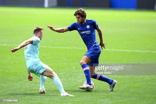 Marcos Alonso of Chelsea and Todd Kane of QPR during a friendly match between Chelsea and Queens Park Rangers at Stamford Bridge on June 14 2020 in...