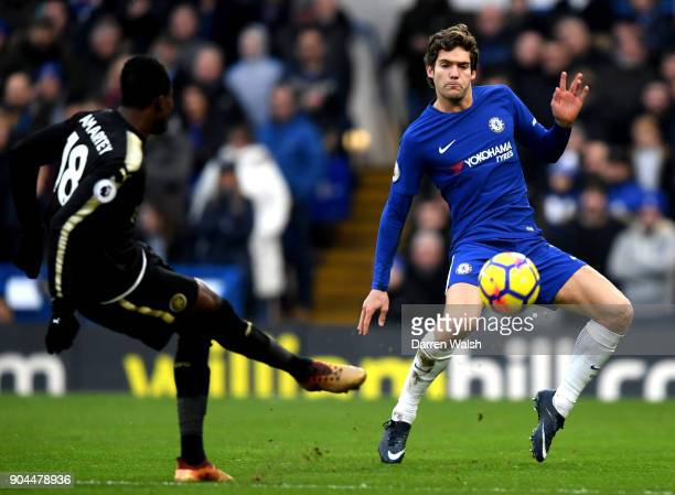 Marcos Alonso of Chelsea attempts to block Daniel Amartey of Leicester City pass during the Premier League match between Chelsea and Leicester City...