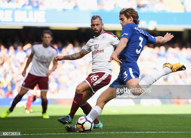 Marcos Alonso of Chelsea attempts to cross as Steven Defour of Burnley attempts to block during the Premier League match between Chelsea and Burnley...