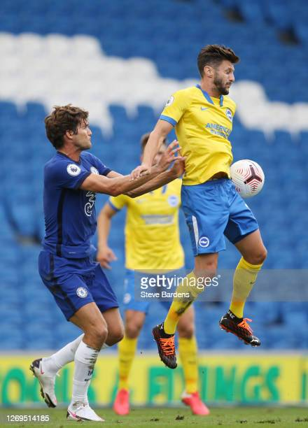 Marcos Alonso of Chelsea battles for possession with Adam Lallana of Brighton and Hove Albion during the preseason friendly between Brighton Hove...